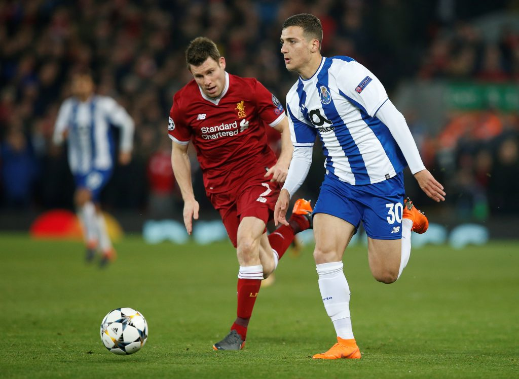 Porto's Diogo Dalot in action with Liverpool's James Milner.