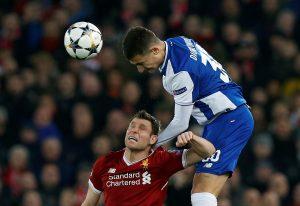 Porto's Diogo Dalot in action with Liverpool's James Milner.