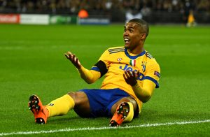 Juventus' Douglas Costa reacts after he is not awarded a penalty.