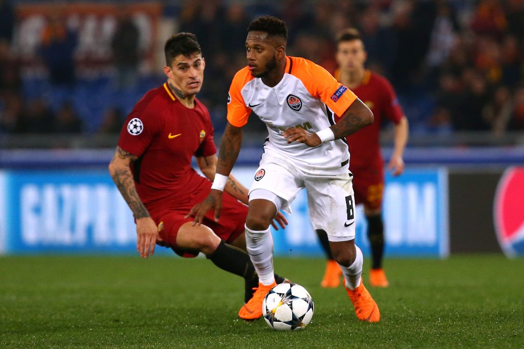 Shakhtar Donetsk's Fred in action with Roma's Diego Perotti.