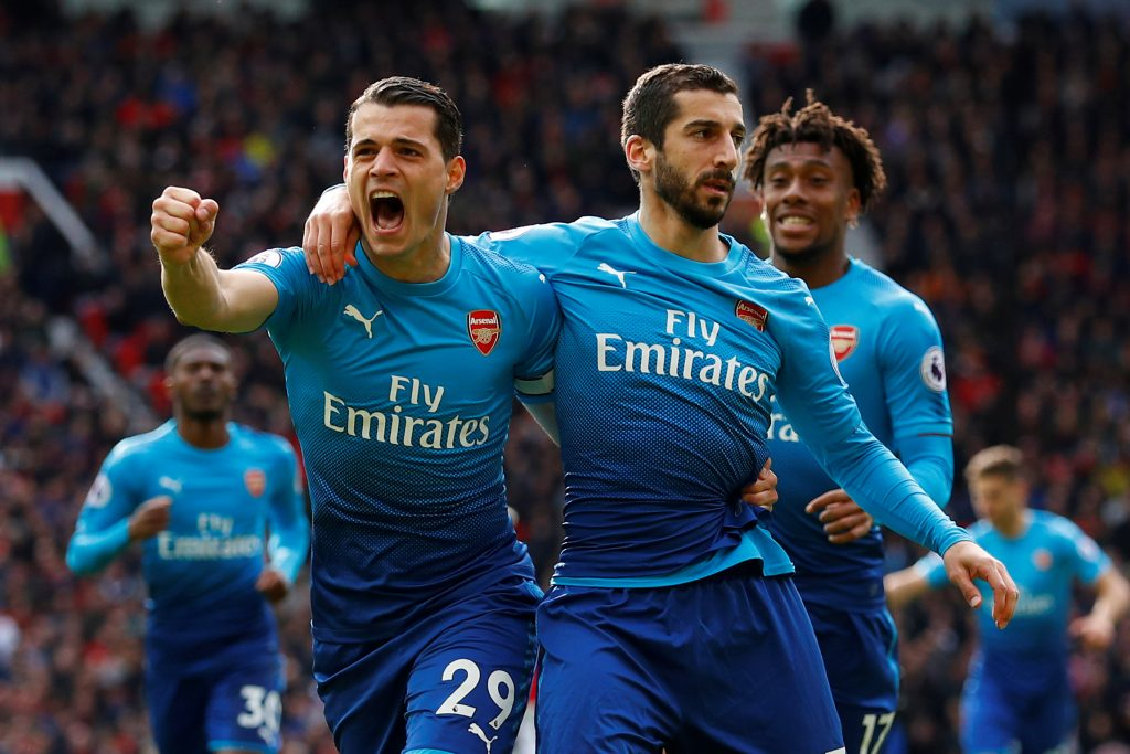 Arsenal's Henrikh Mkhitaryan celebrates scoring their first goal with Granit Xhaka and Alex Iwobi.