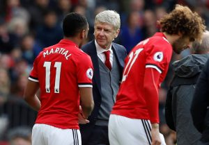 Manchester United's Anthony Martial shakes hands with Arsenal manager Arsene Wenger before coming on as substitute.
