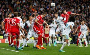 Bayern Munich's Robert Lewandowski heads at goal.