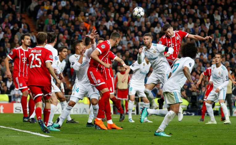 Bayern Munich's Robert Lewandowski heads at goal.