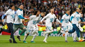 Real Madrid's Sergio Ramos, Karim Benzema and Marcelo and teammates celebrate after the match.