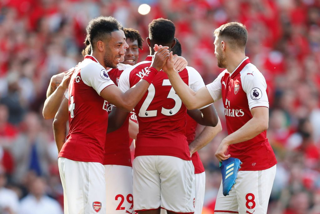 Arsenal's Pierre-Emerick Aubameyang celebrates scoring their fifth goal with Aaron Ramsey and team mates.