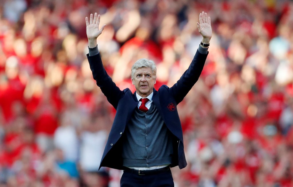 Arsenal manager Arsene Wenger waves to the fans after the match.