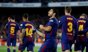 Barcelona's Luis Suarez celebrates scoring their first goal.