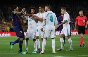 Barcelona's Luis Suarez clashes with Real Madrid's Casemiro, Sergio Ramos and Marcelo.