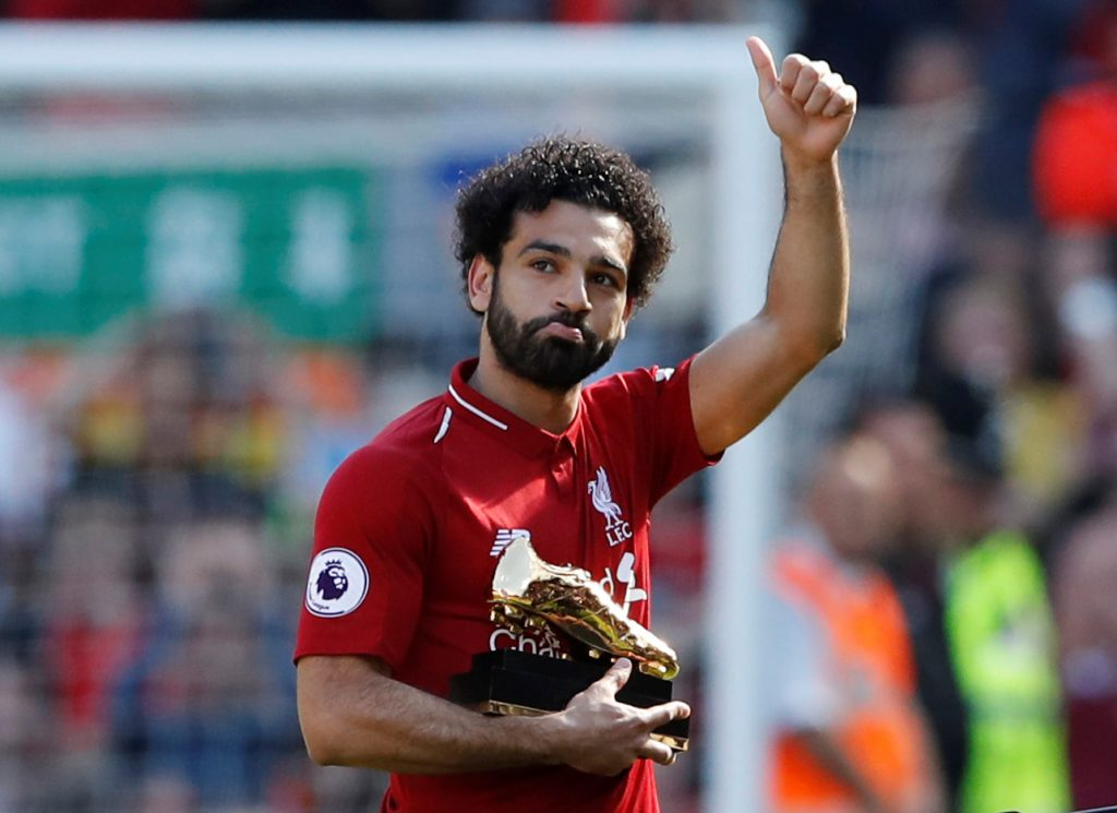 Liverpool's Mohamed Salah celebrates with the Golden Boot after the match.