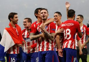 Atletico Madrid's Saul Niguez and team mates celebrate winning the Europa League.