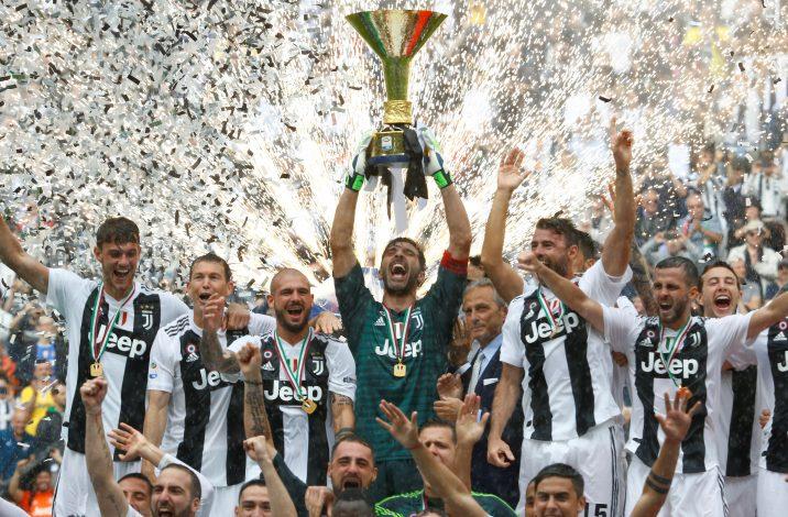 Juventus' Gianluigi Buffon lifts the trophy as the Juventus players celebrate winning the league.