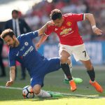 Manchester United's Alexis Sanchez in action with Chelsea's Cesc Fabregas.