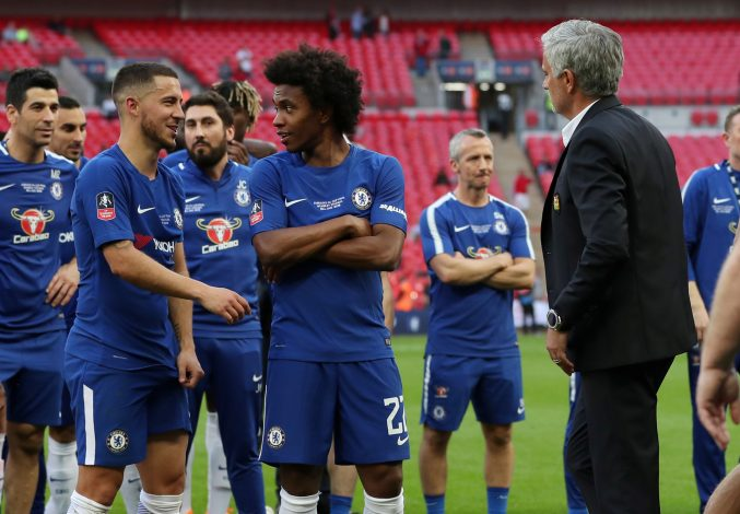 Jose Mourinho with Chelsea's Willian, Eden Hazard and team mates at the end of the match.