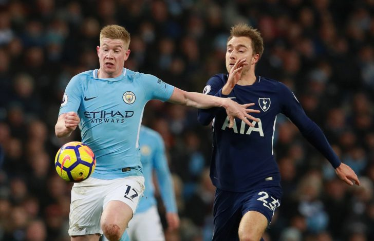 Manchester City's Kevin De Bruyne in action with Tottenham's Christian Eriksen.