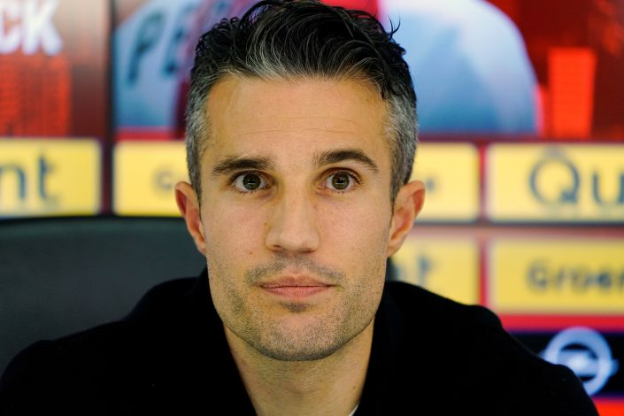 Robin van Persie attends a news conference.