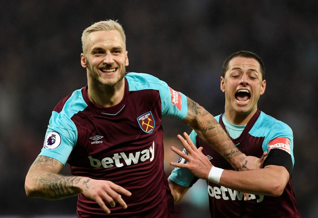 West Ham United's Marko Arnautovic celebrates scoring their second goal with Javier Hernandez.