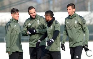 Juventus' Douglas Costa, Gonzalo Higuain (2nd L) and Paulo Dybala (L) during training.