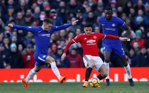 Manchester United's Alexis Sanchez in action with Chelsea's Eden Hazard and Antonio Rudiger.
