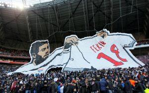 Olympique Lyonnais fans display a banner of Nabil Fekir before the match.