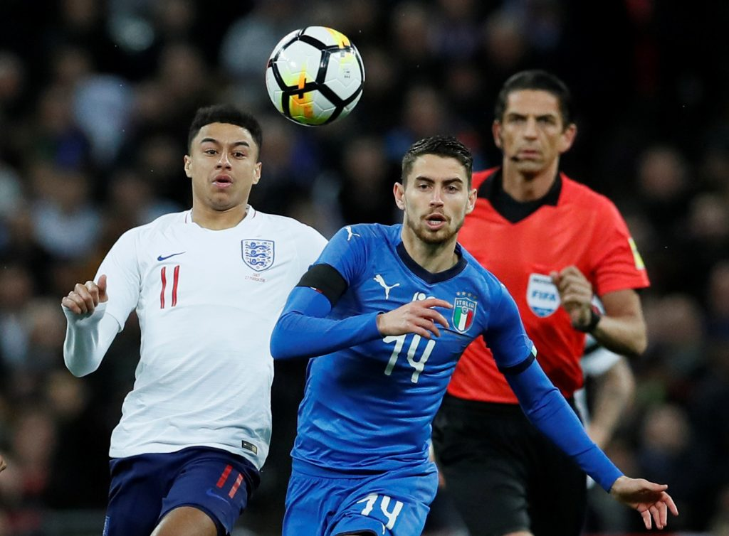 England's Jesse Lingard in action with Italy's Jorginho.