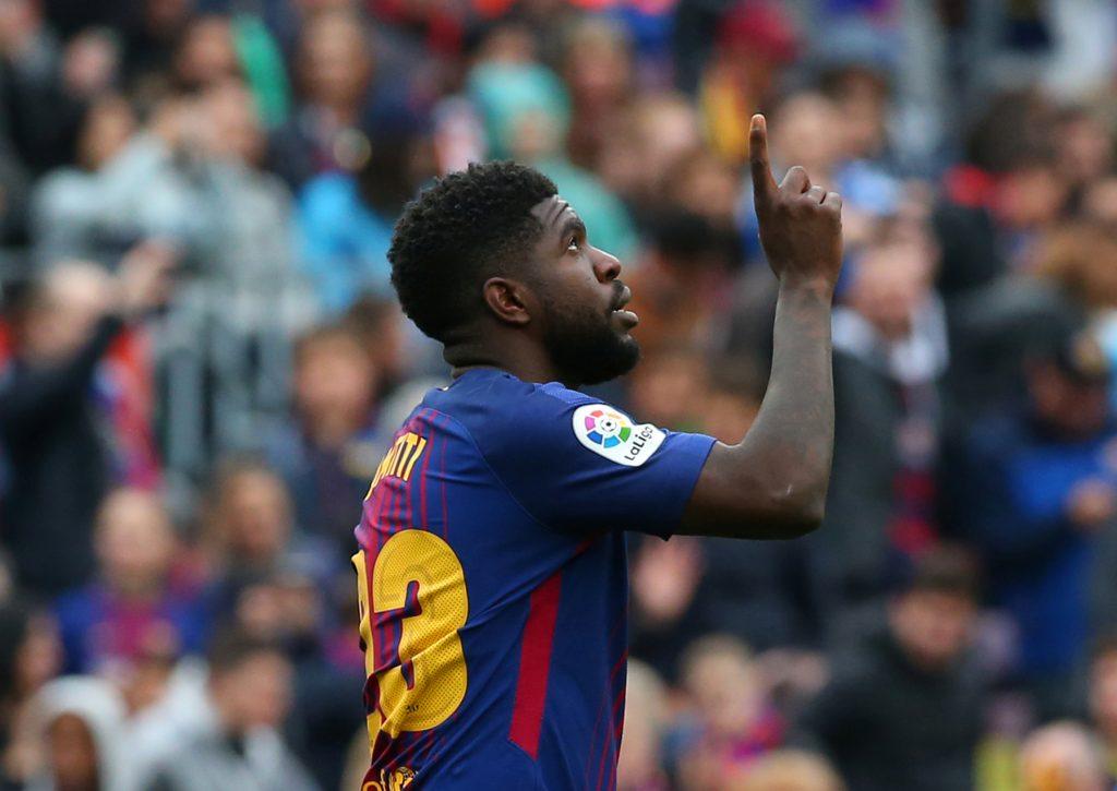 Barcelona's Samuel Umtiti celebrates scoring their second goal.