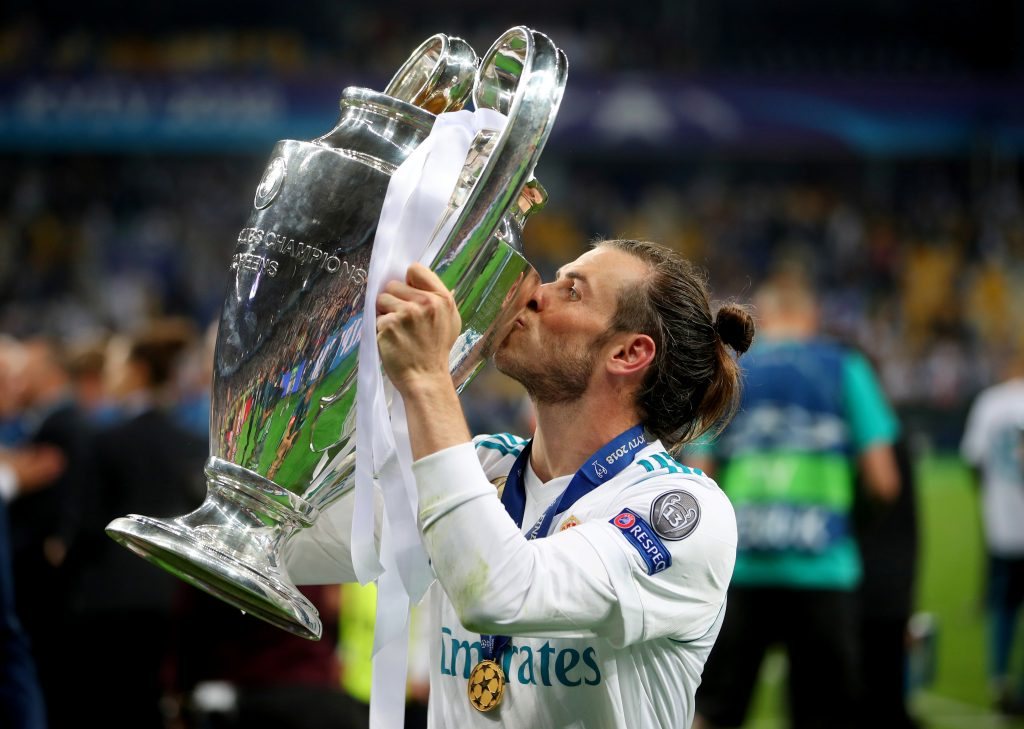 Real Madrid's Gareth Bale celebrates winning the Champions League by kissing the trophy.