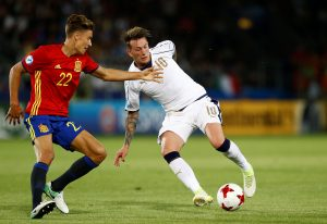 Italy's Federico Chiesa in action with Spain's Marcos Llorente.