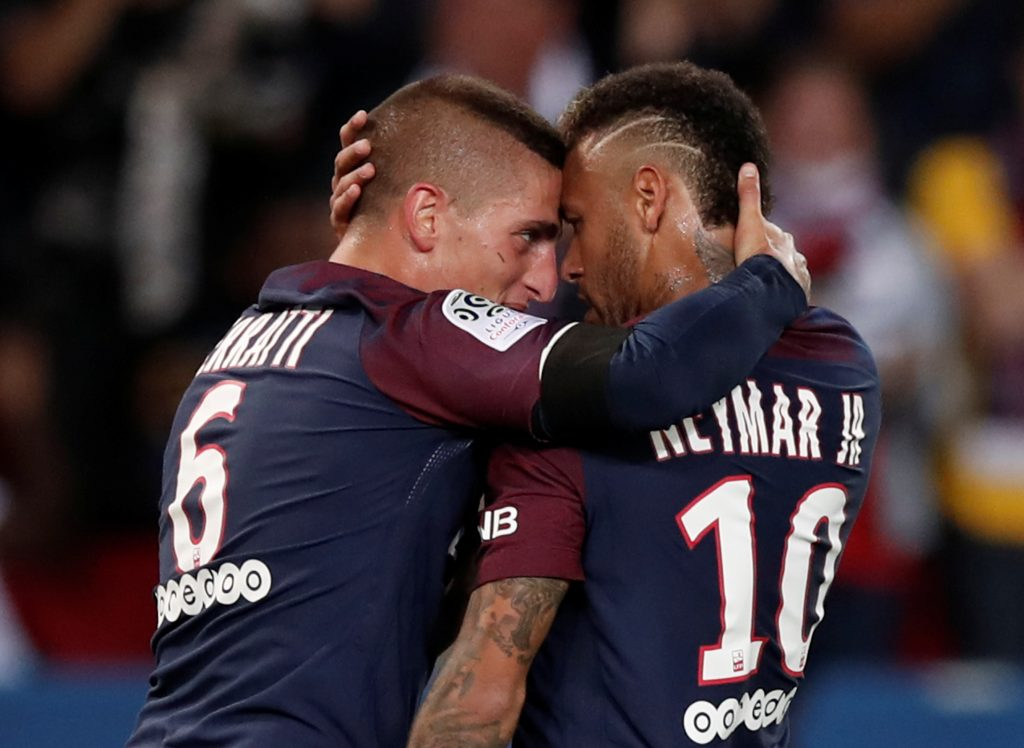 Paris Saint-Germain's Neymar celebrates scoring their first goal with Marco Verratti.