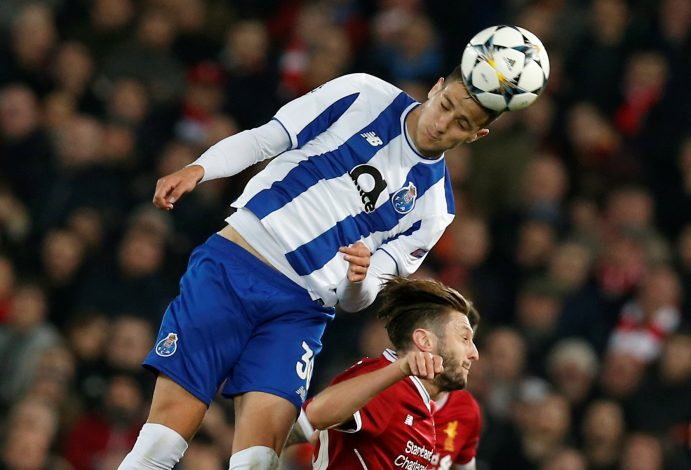 Porto's Diogo Dalot in action with Liverpool's Adam Lallana.