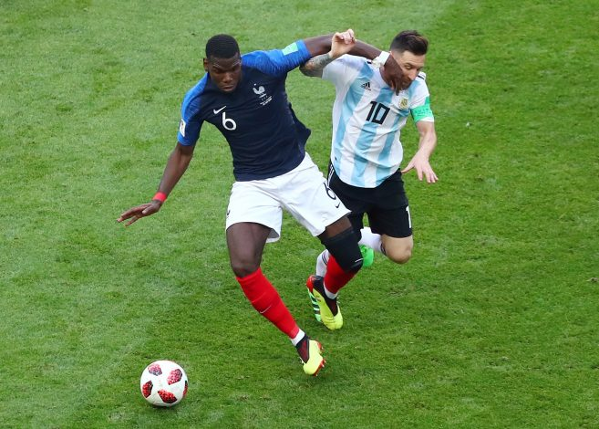France's Paul Pogba in action with Argentina's Lionel Messi.