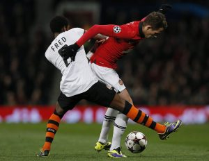 Adnan Januzaj (R) is challenged by Shakhtar Donetsk's Fred during their Champions League soccer match at Old Trafford.