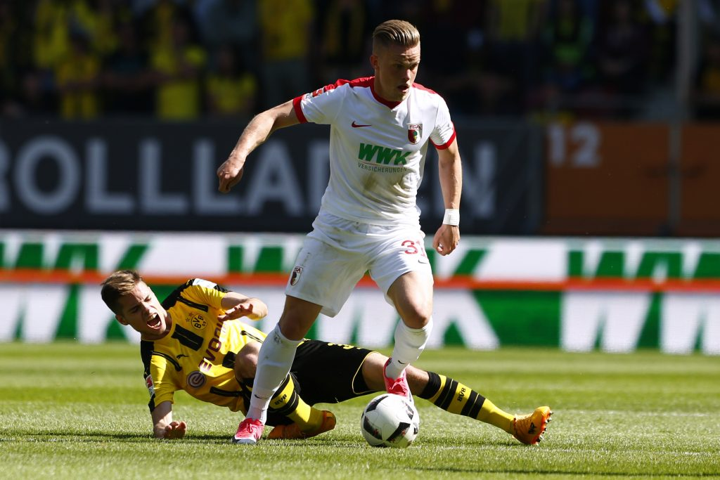 Football Soccer - FC Augsburg v Borussia Dortmund - Bundesliga - Augsburg Arena - 13/5/17 Augsburg's Philipp Max in action with Borussia Dortmund's Julian Weigl  Reuters / Michaela Rehle Livepic DFL RULES TO LIMIT THE ONLINE USAGE DURING MATCH TIME TO 15 PICTURES PER GAME. IMAGE SEQUENCES TO SIMULATE VIDEO IS NOT ALLOWED AT ANY TIME. FOR FURTHER QUERIES PLEASE CONTACT DFL DIRECTLY AT + 49 69 650050. - 14792698