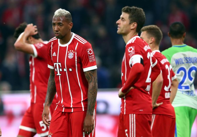 Bayern Munich's Jerome Boateng (L) and Thomas Muller look dejected after the match.