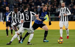 Inter Milan's Marcelo Brozovic in action with Juventus' Blaise Matuidi and' Miralem Pjanic.