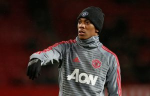 Manchester United's Anthony Martial warms up before the match.