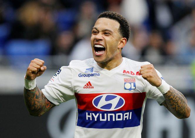 Lyon's Memphis Depay celebrates scoring their second goal.