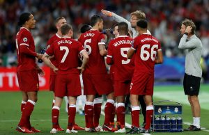 Liverpool manager Jurgen Klopp gives instructions to Liverpool players during a break in play.