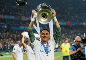 Real Madrid's Keylor Navas celebrates with the trophy after winning the Champions League.