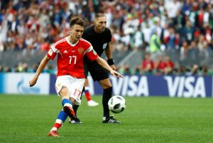 Russia's Aleksandr Golovin scores their fifth goal from a free kick.