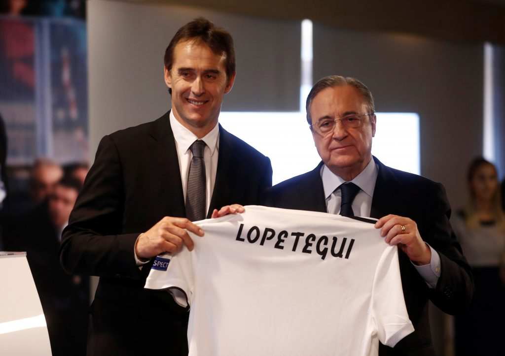 New Real Madrid coach Julen Lopetegui poses with the shirt with president Florentino Perez during the presentation.