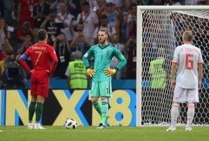 Portugal's Cristiano Ronaldo prepares to take a penalty as Spain's David De Gea looks on.
