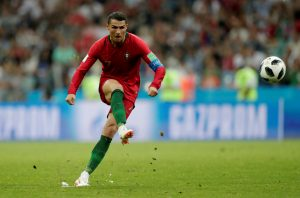 Portugal's Cristiano Ronaldo scores their third goal from a free kick to complete his hat-trick.