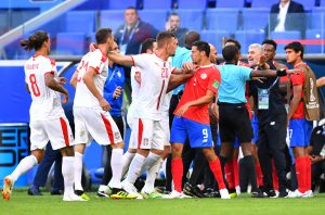 Serbia's Sergej Milinkovic-Savic separates Nemanja Matic and Costa Rica's Daniel Colindres following a clash.