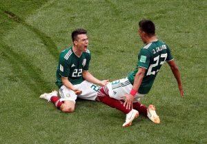 Mexico's Hirving Lozano celebrates scoring their first goal with Jesus Gallardo.
