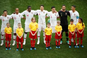 Portugal players line up during the national anthems before the match.