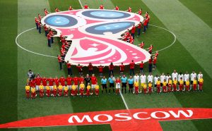 General view of both teams and officials lined up before the match.