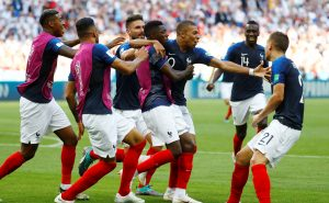 France's Kylian Mbappe celebrates with team mates after scoring their fourth goal.