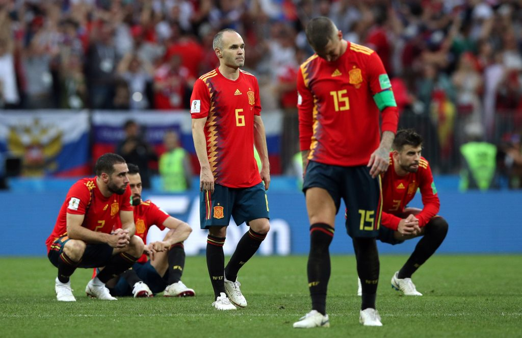 Soccer Football - World Cup - Round of 16 - Spain vs Russia - Luzhniki Stadium, Moscow, Russia - July 1, 2018  Spain's Sergio Ramos and Andres Iniesta look dejected after losing the penalty shootout   REUTERS/Albert Gea - RC1B6AD78D70