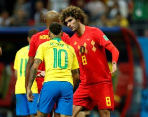 Belgium's Marouane Fellaini with Brazil's Neymar.